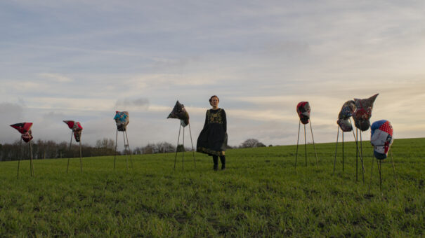 Jane with her textile sculptures 'Fetishes for Uncertain Times'